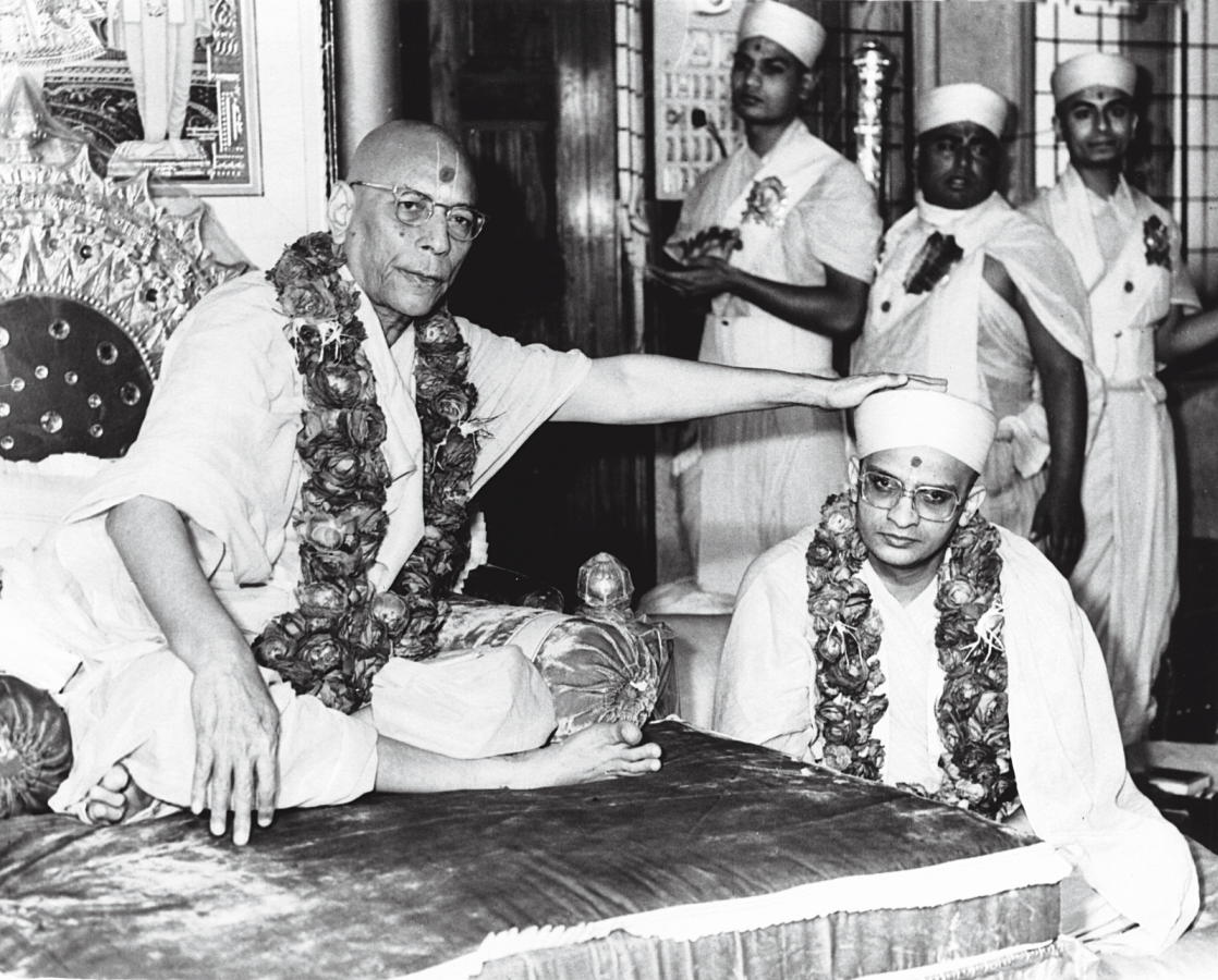 "On Wednesday 28 February 1979 (Samvat 2035 Falgun Sud 2), Jeevanpran Shree Muktajeevan Swamibapa appointed Swamishree to be His heir and subsequent Acharya of Shree Swaminarayan Gadi. During the investiture ceremony, Jeevanpran Swamibapa stated, ""I hand over the helm of the Karan Satsang – Shree Swaminarayan Gadi to Shree Purushottampriyadasji Swami. In every respect, Lord Shree Swaminarayan, Jeevanpran Bapashree and I, will work through Him, and will always remain with Him."""