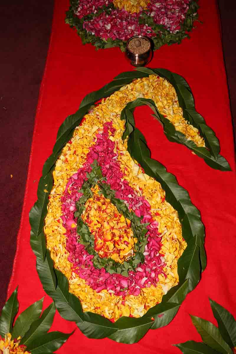 Flower rangoli inside the temple