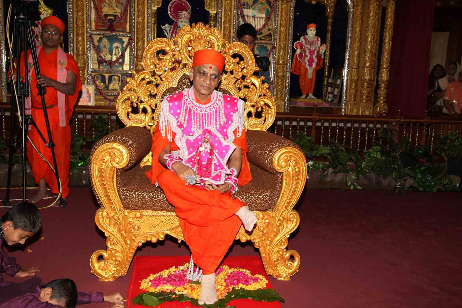 Acharya Swamishree residing on the throne
