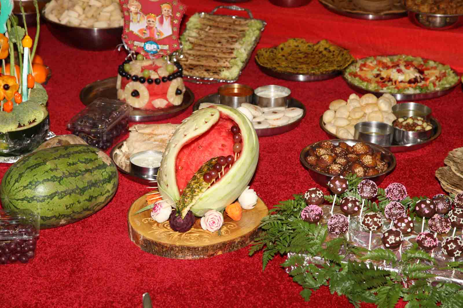 One of the many characters crafted using various fruits and vegetables by talented Sants and devotees