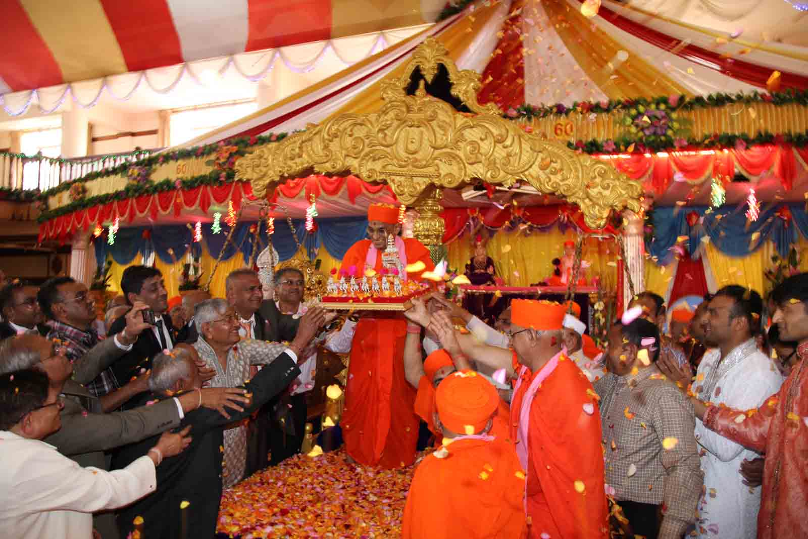 A silver chariot with horses presented to Acharya Swamishree by the devotees