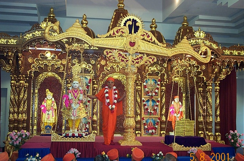 Grand opening of Shree Swaminarayan Mandir, Secaucus, New Jersey. The divine Murtis were ceremonially weighed in a grand tula with 780 kg gold as part of the installation ceremony, 5 August 2001