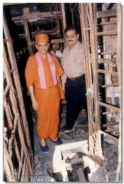 Acharya Swamishree views the inside of the destroyed carriage