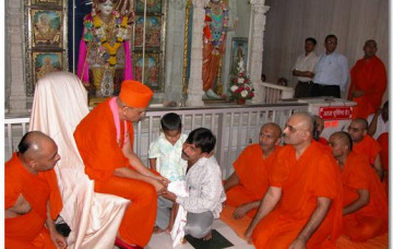 Acharya Swamishree Provides Medical Aid to a Tortured Blind Boy