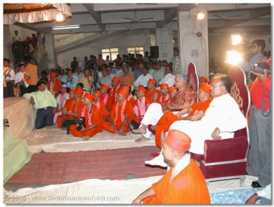 Acharya Swamishree, sants, guests, and devotees watch the dance performances