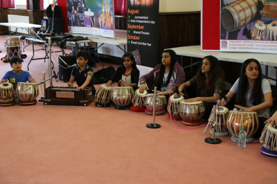 Young disciples play traditional Indian instruments