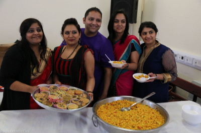 Disciples serve traditional Indian sweets and savouries