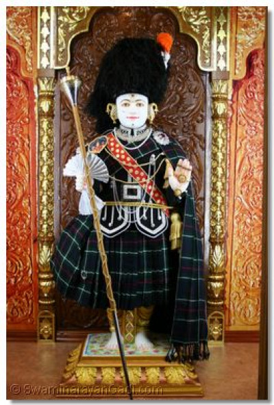 Ghanshyam Maharaj looking exceptionally divine in the band uniform.