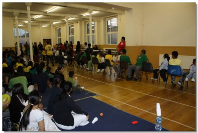 Participants aged 4-10 playing Musical chairs.