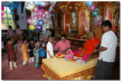 Young disciples present gifts to beloved father Acharya Swamishree