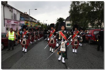 The pipe bands march along the streets of Bowness
