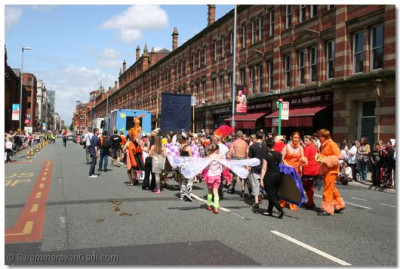 Different groups performing at the Manchester Parade