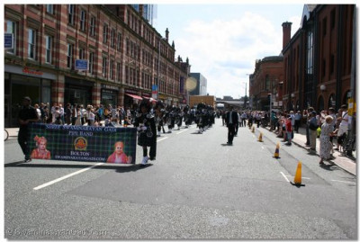 Shree Swaminarayan Gadi Pipe Band performing at the Manchester Parade