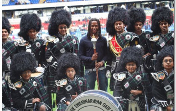 Swaminarayan Gadi Pipe Band Performs at Reebok Stadium