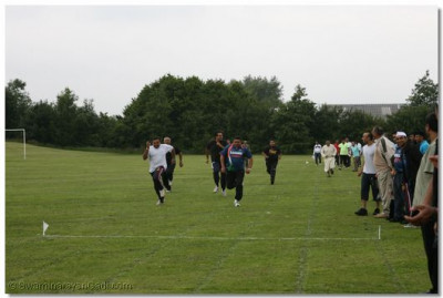 Disciples take part in the 100m dash