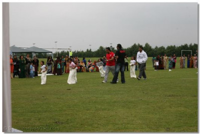 Younger disciples take part in the sack race