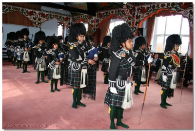 Shree Swaminarayan Gadi Pipe Band perform to welcome the honoured guests