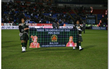 Bolton and London pipe bands perform at the Reebok Stadium