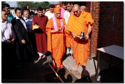 His Divine Holiness Acharya Swamishree performs the auspicious ground breaking ceremony before the start of new works outside Shree Swaminarayan Temple Bolton