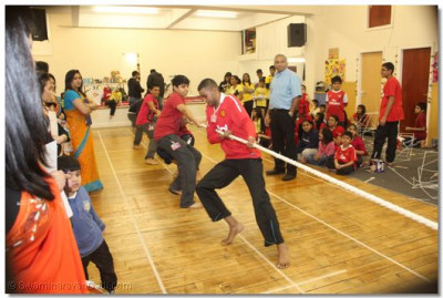 Participants take part in tug a war.
