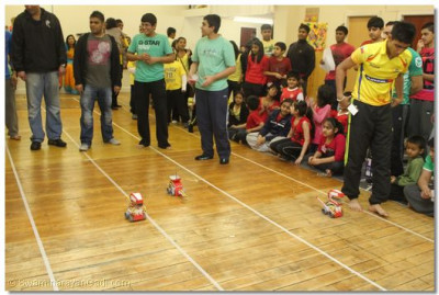 Participants take part in a radio control car race.