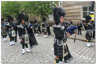 Shree Swaminarayan Gadi Pipe Band waits for the The Olympic Torch
