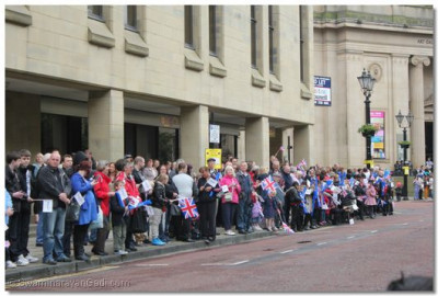 Crowds wait for the The Olympic Torch