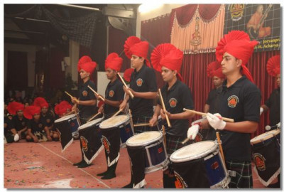 Drummer's pleasing Lord Swaminarayan