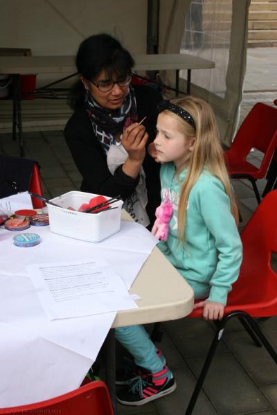 Disciples offer face painting to young children
