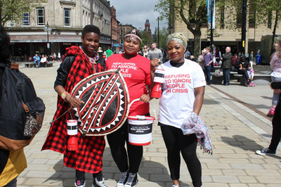 Traditional African Dancers aid devotees in collecting donations for Nepal Earthquake victims