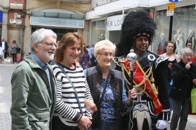 Members of the public are delighted to witness band performance