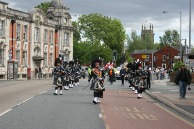 Shree Swaminarayan Gadi Pipe Band Bolton perform in the community carnival in Radcliffe