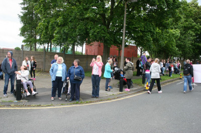 Delighted local residents gather and watch the carnival pass