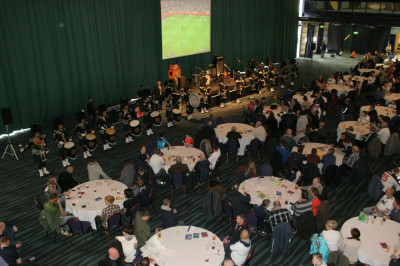 Shree Swaminarayan Gadi Pipe Band performing at lunch with special guests at the Macron Stadium.