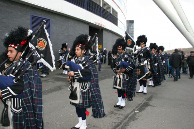 Shree Swaminarayan Gadi Pipe Band Bolton perform outside the grounds of the Macron stadium