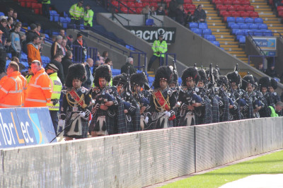 Shree Swaminarayan Gadi Pipe Band Bolton perform inside Macron stadium