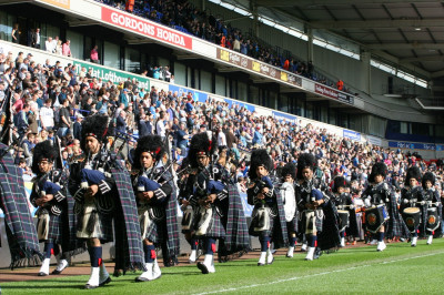 Shree Swaminarayan Gadi Pipe Band Bolton perform on the pitch inside Macron stadium