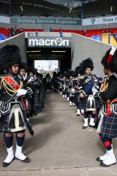 Shree Swaminarayan Gadi Pipe Band Bolton perform in the tunnel of the Macron Stadium