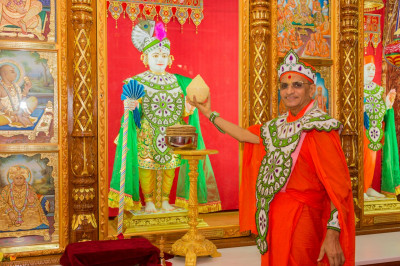 His Divne Holiness Acharya Swamishree offers freshly churned butter to Lord Shree Swaminarayan