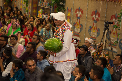 A disciples offers a 12kg water melon