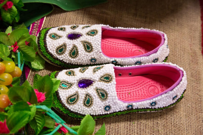 The intricately decorated footware offered to His Divine Holiness Acharya Swamishree as part of the celebrations