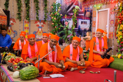 Sants sing traditional devotional songs as part of the festivities