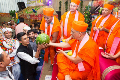 His Divine Holiness Acharya Swamishree blesses all disciples with various fruits and vegetables