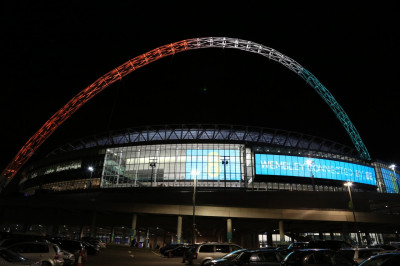 Wembley stadium lit up in the colours of the Indian national flag - orange, white and green