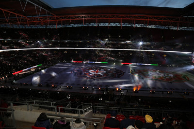 The audience light up the stadium with their mobile phones during one of the performances