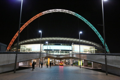 The Wembley Stadium arch is lit with the colours from the Indian national flag