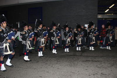 Shree Swaminarayan Gadi Pipe Band Bolton perform at the Bolton vs. Liverpool FA Cup fourth round football match at the Macron Stadium