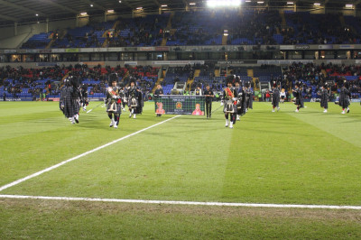 Shree Swaminarayan Gadi Pipe Band Bolton perform at the Bolton vs. Liverpool FA Cup fourth round football match inside the grounds of the Macron Stadium
