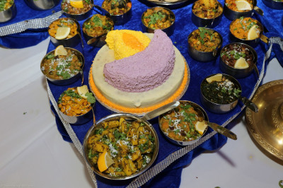 A huge variety of sweet and savoury dishes are offered to the Lord including a diwa shaped cake