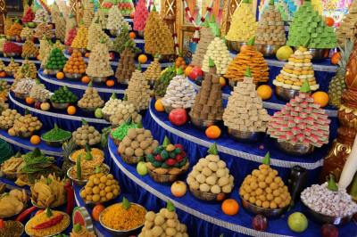 Sweet and savoury items are arranged as annakut and offered to the Lord